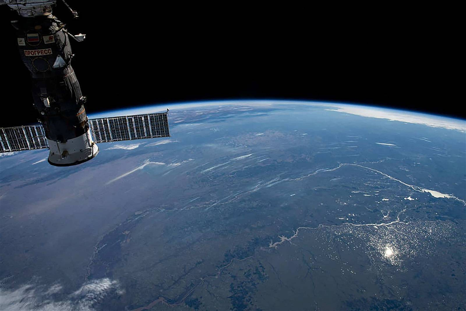 This photograph of the Earth's horizon looks back towards Uruguay as the International Space Station orbited just off the coast of the South American nation. The Progress 75 cargo craft from Russia is pictured in the left foreground. Credits: NASA