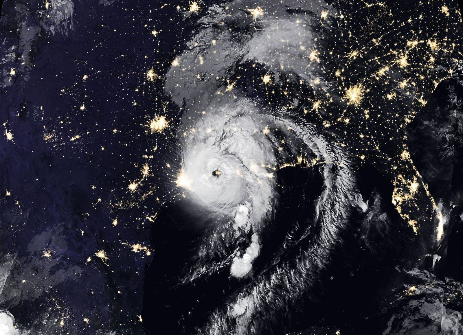After making landfall near Cameron, Louisiana, as a category 4 storm, Hurricane Laura continued to move northward over western Louisiana. The Visible Infrared Imaging Radiometer Suite (VIIRS) on NOAA-20 acquired this image of Hurricane Laura at 2:50 a.m. Central Daylight Time on August 27, 2020, about two hours after the storm made landfall. Clouds are shown in infrared using brightness temperature data, which is useful for distinguishing cooler cloud structures from the warmer surface below. That data is overlaid on composite imagery of city lights from NASA's Black Marble dataset. Credits: NASA's Earth Observatory