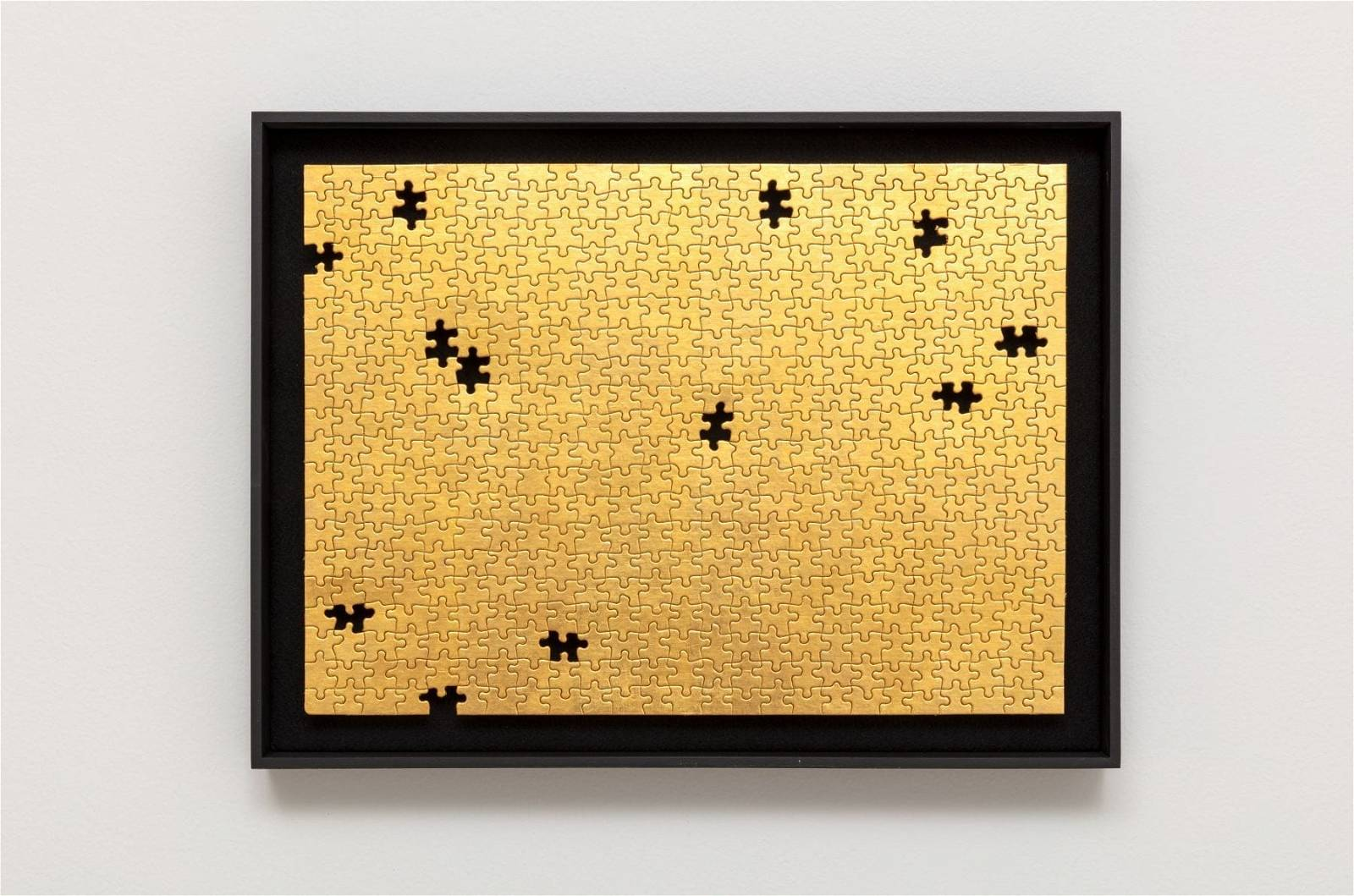 Gabriel Dawe, Missing No. 3, 2019, 24 karat gold on puzzle in artist frame, 13h x 18w in, image courtesy of the artist and Talley Dunn Gallery
