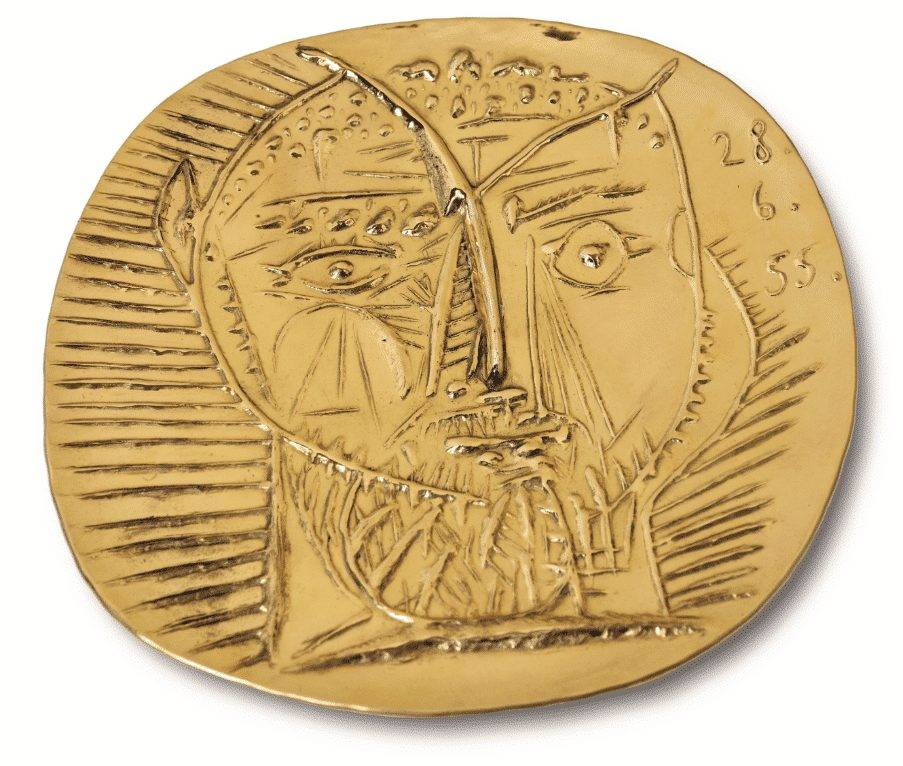 Pablo Picasso (1881-1973), Visage de faune, dated '28.6.55.' (upper right), 22-carat gold repoussé plate with wooden presentation box, 25cm (9 3/4in). diameter. Conceived in 1955; this unique example in gold executed in 1968 by François and Pierre Hugo. Estimate: £250,000-350,000